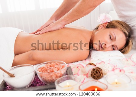 Client relaxing in massage at the spa - stock photo