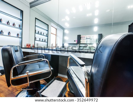 Client's chair in barber shop.Selective focus