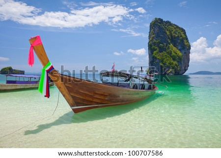 Cliff and boats and the clear sea Phi Phi Leh south of Thailand - stock photo