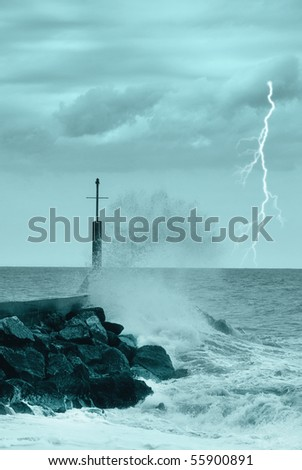 cliff covered by the waves - stock photo