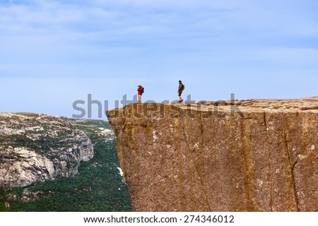 Cliff Preikestolen in fjord Lysefjord - Norway - nature and travel background - stock photo