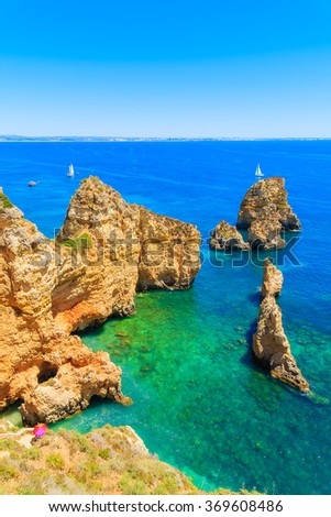 Cliff rocks and sea bay with turquoise water at Ponta da Piedade, Algarve region, Portugal - stock photo