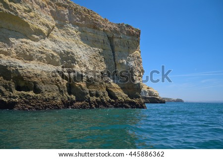 Cliff scenery from a tour boat near Carvoeiro, in Algarve, Portugal. Travel and vacation destinations - stock photo