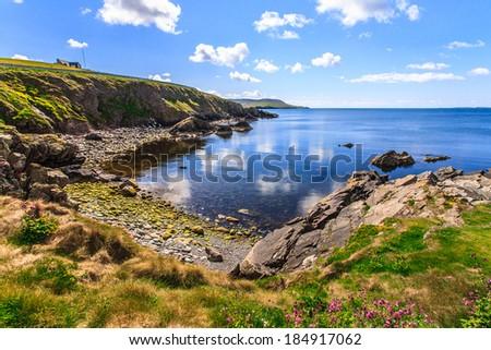 Cliff under cloudy sky, Lerwick, Shetland, Scotland, UK - stock photo