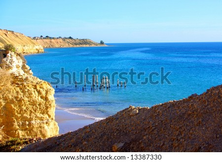 Cliffs and the historic ruined jetty at Port Willunga and the Gulf St Vincent (Adelaide, Australia).