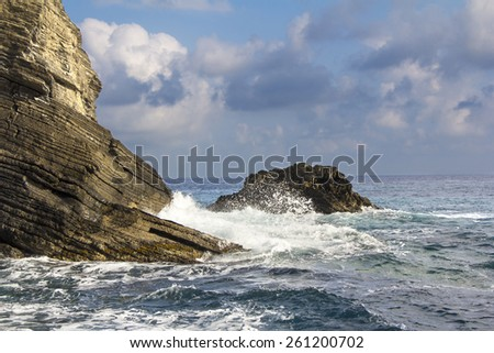 Cliffs and waves in Vernazza, Cinque Terre, Liguria, Italy - stock photo