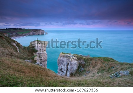 cliffs in Atlantic ocean in France during sunrise