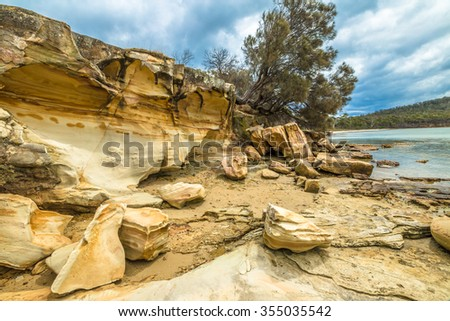 Cliffs of Lime Bay beach camping inside the Lime Bay State Reserve, located at the northern end of the Tasman Peninsula to the west of Whitehouse Point. Tasmania, Australia. - stock photo