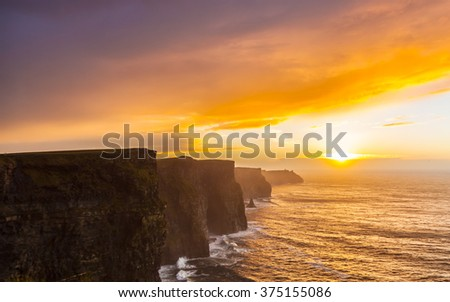 Cliffs of Moher at sunset in Co. Clare Ireland Europe. Beautiful landscape. - stock photo