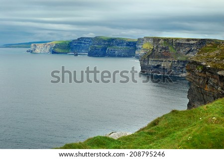 Cliffs of Moher at the coast of Ireland and view on the Atlantic ocean - stock photo