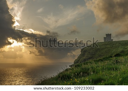 Cliffs of Moher Sunset, O Briens Tower, County Clare, Ireland. - stock photo