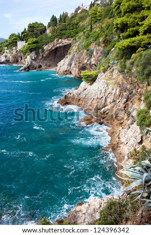 Cliffs on the Adriatic Sea scenic coastline near Dubrovnik in Southern Croatia, Dalmatia region. - stock photo
