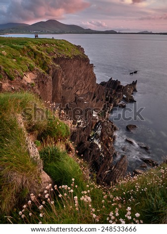 Cliffs on the Dingle Way in Western Ireland on a sunny evening at sunset - stock photo