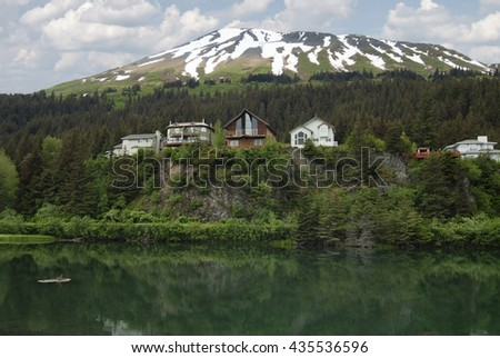 Cliffside lodges / wooden houses on Cliff View Place Looking Over The Lagoon, Seward, Kenai Peninsula Borough, Alaska, USA - stock photo