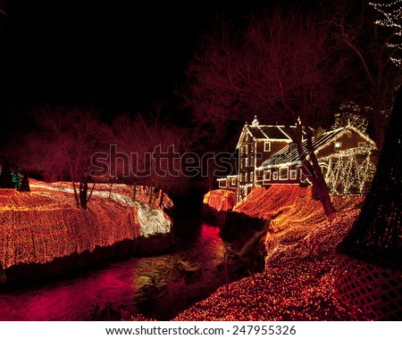 CLIFTON, OHIO - DECEMBER 12, 2014:  Clifton Mill is adorned with 3.5 million festive Christmas lights.  Located in Clifton, Ohio, this is a premiere attraction in the midwestern United States. - stock photo