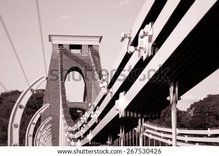 Clifton Suspension Bridge by Brunel, Bristol, England, UK in Black and White Sepia Tone - stock photo