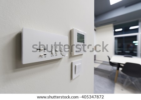 Climate control on office wall, selective focus - stock photo