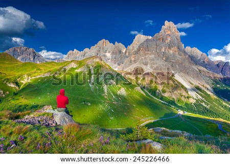Climber admiring of the landscape of Pale di San Martino, Trentino - Dolomites, Italy. Cimon della Pala mountain ridge. - stock photo