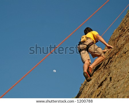 Climber climbs up California Cliff at Sunset and moon rise - stock photo