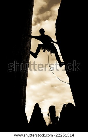 Climber clings to the edge of a steep rock precipice in The Sierra Nevada Mountains, California. - stock photo