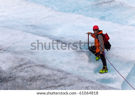 climber on ice of Norwegian glacier - stock photo