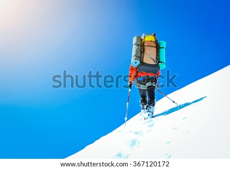 Climber on snowy summit - stock photo