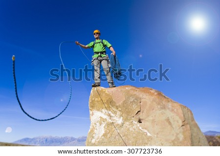 Climber on the edge of a challenging cliff.