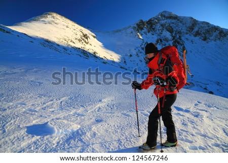 Climber on the mountain during winter, Retezat mountains, Romania - stock photo