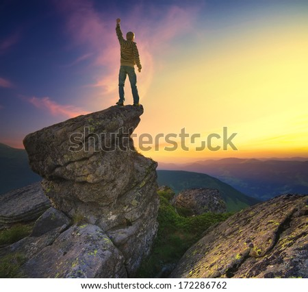 Climber on the mountain top. Sport and active  life concept - stock photo