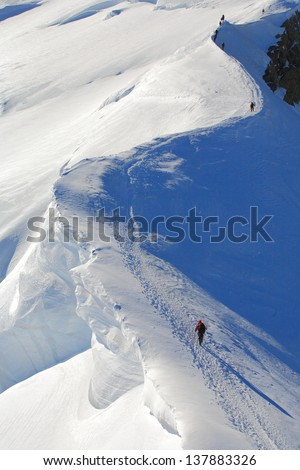 Climber on the snowy route to Mont Blanc summit - stock photo