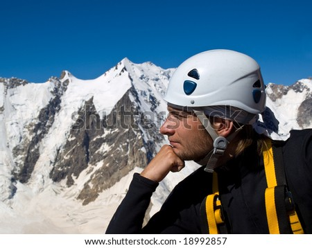 Climber on the top of mountain. Thinker