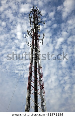 Climber on the top of the 280' self support tower installing antennas - stock photo