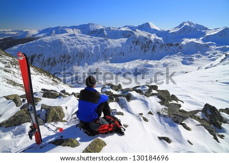 Climber resting and admiring the view - stock photo