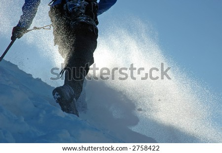 Climber struggling in a snowstorm - stock photo