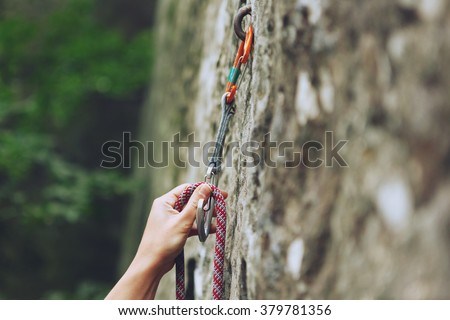 climbers hold and quick-draw - stock photo