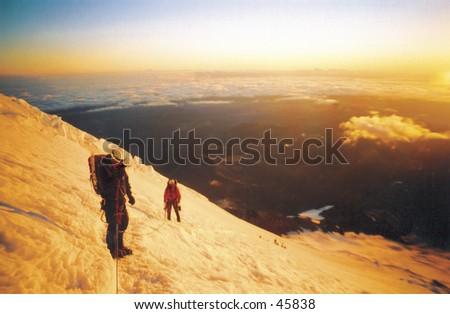 Climbers on Mount Rainier - stock photo