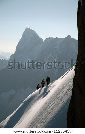 Climbers on ridge in French Alps - stock photo