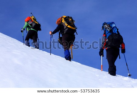 Climbing alpinists - stock photo
