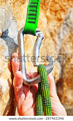 Climbing equipment - rope, carabiner - stock photo
