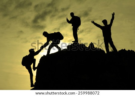 climbing help & climbing team - stock photo