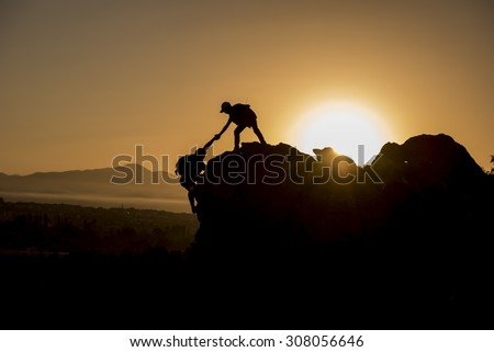 climbing help & success peak - stock photo