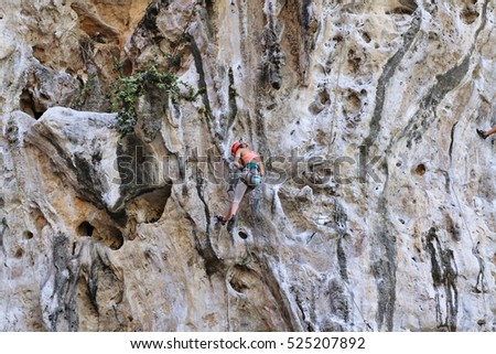 Climbing man woman thailand Ton Sai beach cliff rock extreme sports