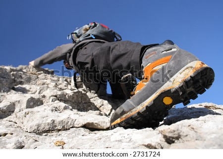 Climbing on the rocks - stock photo