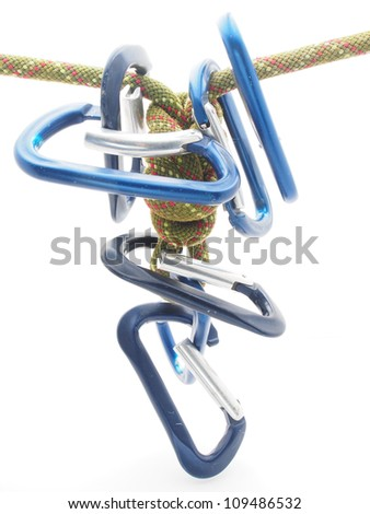 climbing rope and a carabiner on a white background - stock photo