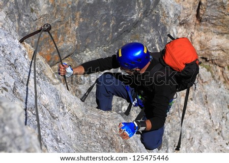 Climbing the Olivieri via ferrata route, Dolomite Alps - stock photo