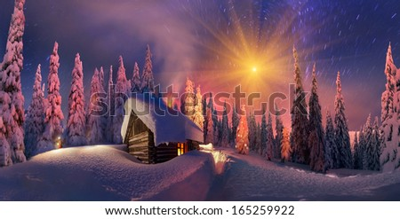 Climbing to tourist wild alpine mountain to an abandoned cabin-in order to illuminate the snow-covered spruce canopy during moonrise, moonset, to see the first star of Christmas in the Carpathians. - stock photo