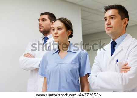 clinic, profession, people, health care and medicine concept - group of medics or doctors at hospital corridor - stock photo
