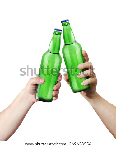 Clink glasses. Two hands holding a bottles. Template for the ability to use any brand label on a white background - stock photo