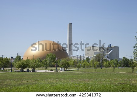 CLINTON, IOWA, USA - MAY 18, 2016: The golden dome and buildings of the Archer Daniels Midland cogeneration power plant in Clinton, Iowa. - stock photo