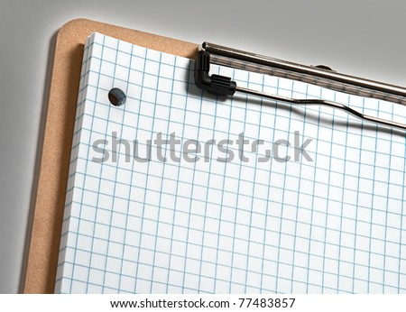 Clip board with grid paper and grey border - stock photo